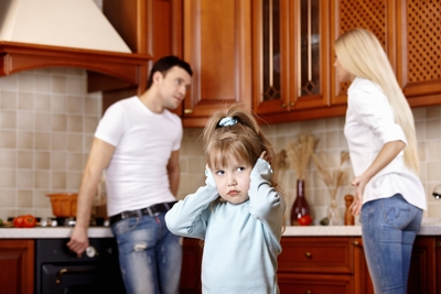 child listening to her parents arguing